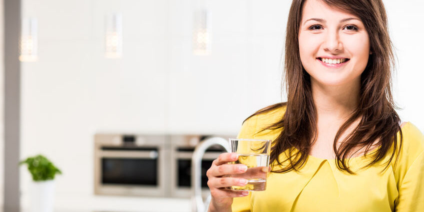 Young beauty woman with glass of water